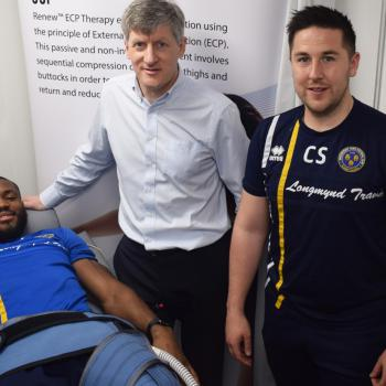 John Buckley, Professor of Applied Exercise Science at University Centre Shrewsbury (centre), and Shrewsbury Town FC Physiotherapist, Chris Skitt, demonstrating the ECP Therapy treatment with Shrewsbury Town FC player Lenell John-Lewis.